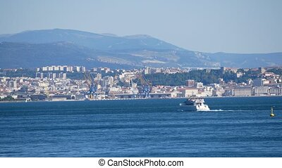 Moving ships against Trieste city harbour and seaport, Italy...