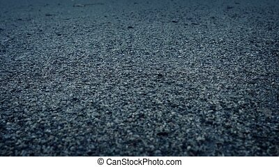 Moving Slowly Over Gravel Surface - Closeup tracking shot of...