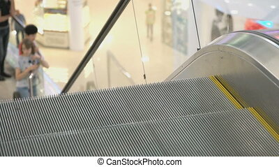 Moving staircase of escalator. Close-up