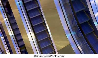 Moving steps of the escalator at the mall.