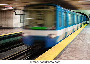 Moving subway train with an empty subway platform.