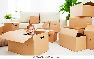 moving to new apartment. happy child in cardboard box