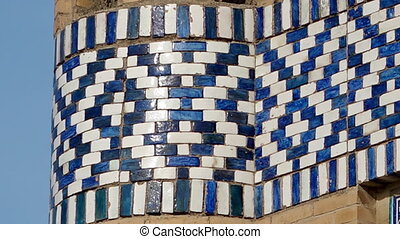 Moving towards a tiled temple pattern - A close-up, panning...