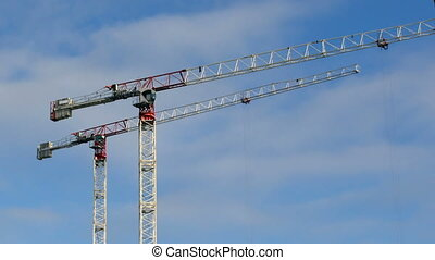 tower cranes in the blue sky