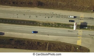 Moving Traffic On Motorway - AERIAL VIEW. The shot directly...