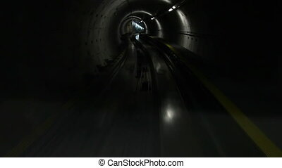 Moving train in subway tunnel