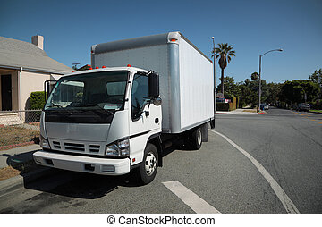 Moving truck on street - White moving truck on suburb street...