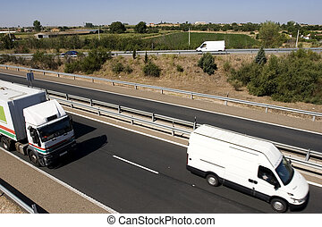 Top view of moving trucks on highway