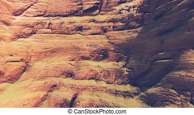 Moving up on the red cliff closeup - Closeup view of the red...