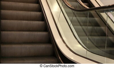 View down of two modern escalators in movement