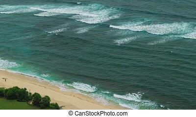 Moving waves on Nunggalan Beach Coastline, Uluwatu, Bali,...