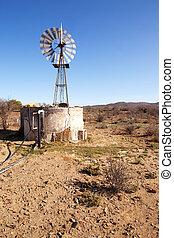 Moving windpump next to dam in Karoo - Wind blown windpump...