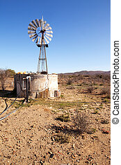 Moving windpump next to dam in Karoo - Wind blown windpump...