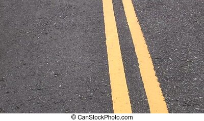 moving yellow lines on the road