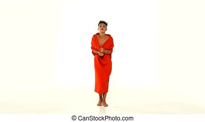 Moving, young woman in red long dress-changeling on white background