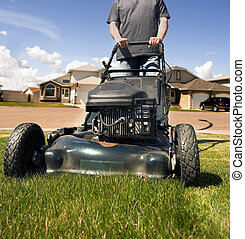 Mow the lawn - mowing the front lawn with houses in the...
