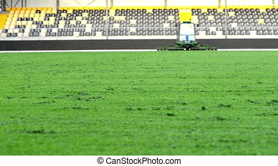 mowing grass in football stadium