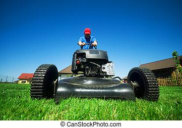 Man mowing the lawn. Gardening