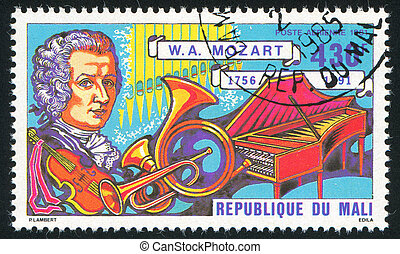 Mozart and instruments - MALI - CIRCA 1981: stamp printed by...