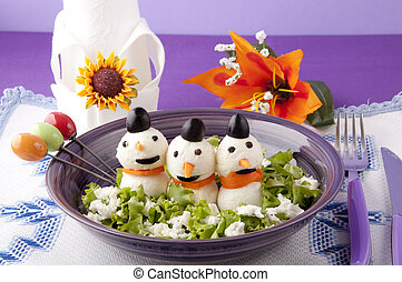 mozzarella cheese in the shape of a snowman on a bed of...