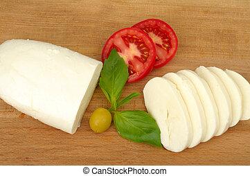 mozzarella cheese on a wooden background