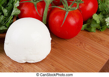 Mozzarella cheese on a wooden plate. Healthy food.