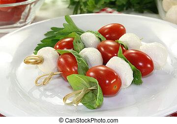 mozzarella skewers - small skewers with mozzarella, tomato...