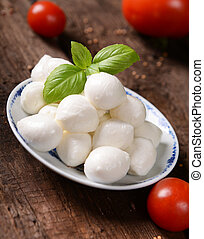 Mozzarella - Tasty mozzarella cheese on old wooden table