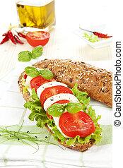 Mozzarella tomato baguette. - Mozzarella tomato baguette on...