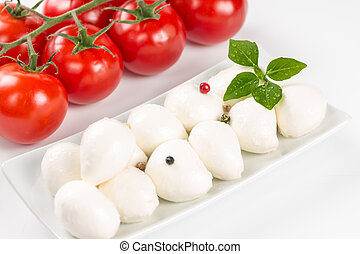 Mozzarella, tomatoes and basil leaves