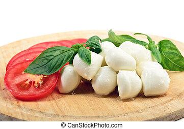 Mozzarella tomatoes basil