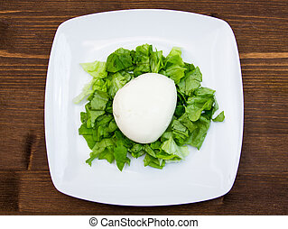 Mozzarella with salad on wooden table top view