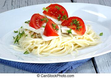 Mozzarella with tomatoes on home made spaghetti