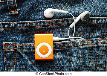 mp3 player with earphones in jeans pocket