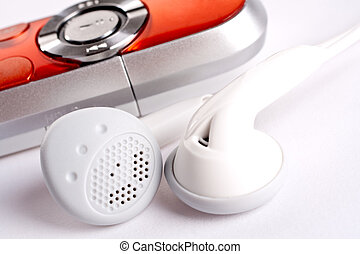 mp3 player with headphoneson on a white background