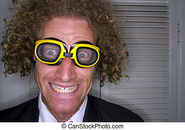A stock photograph of a freaky man with goggles on.