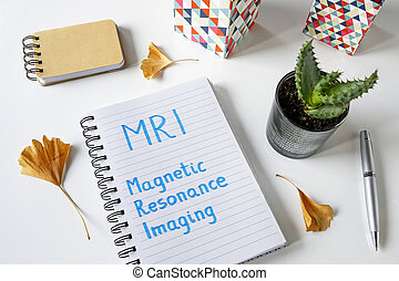MRI Magnetic Resonance Imaging written in a notebook