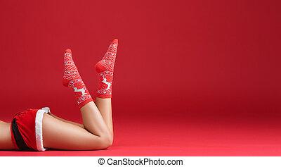 Mrs santa claus legs in Christmas stockings
