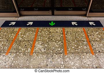 MRT station. - MRT station platform edge. Painted waiting...
