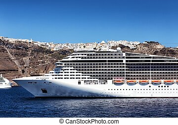 MSC Fantasia cruise ship near Santorini island in Aegean sea