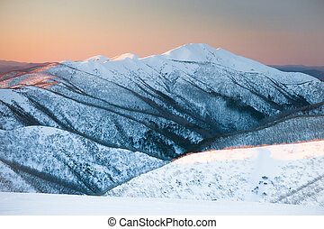 Mt Feathertop at sunset during winter near Mt Hotham in...