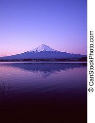 Mt Fuji reflected in Lake Kawaguchiko at dawn