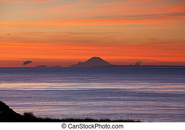 Mt. Rainier over Puget Sound - The bright orange colors of...