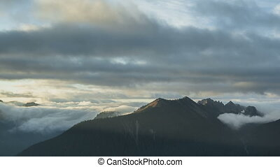 Mt. Rainier - Timelapse of clouds passing the peaks at...