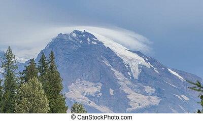 Mt. Rainier - Timelapse of clouds passing the peak of Mt...