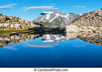 Man looking on Beautiful peak Mount Shuksan in Washington, USA
