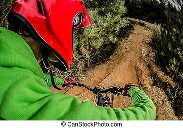 MTB downhill biking in the forest.