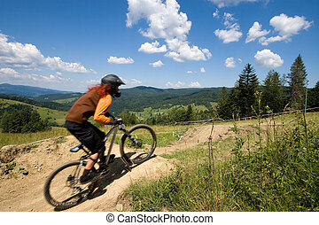 MTB downhill competition - Female mtb biker during downhill...