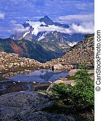 MtShuksan5 - Mt. Shuksan reflecting in a pool of water in...