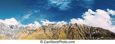 Mtskheta-Mtianeti Region, Georgia. Panorama Of Mountain Peaks. Blue Sunny Sky Over Varied Mountains Landscape In Kazbegi District. Sunny Blue Sky